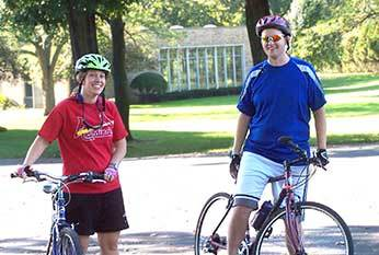 Fr Dan Ponisciak, CSC riding bikes with a friend