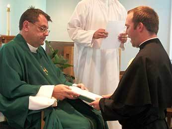Fr Szakaly, CSC receives Deacon Tim Mouton, CSC's renewal of vows