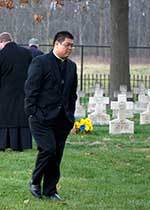 Fr Ching, CSC at the Community Cemetary