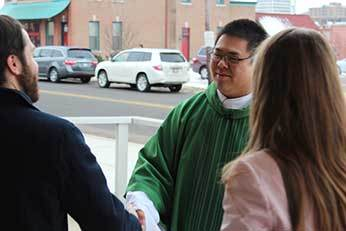 Fr Brian Ching, CSC with Parishioners