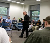 Fr Dan Issing, CSC teaching at King's college
