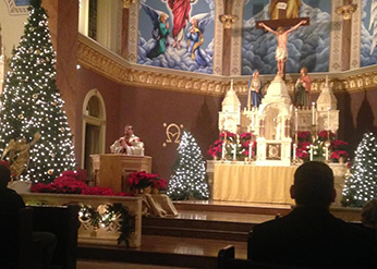 Fr Waugh, CSC offers mass at his home parish in Kansas