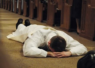 Lying prostrate during the Litany of Saints