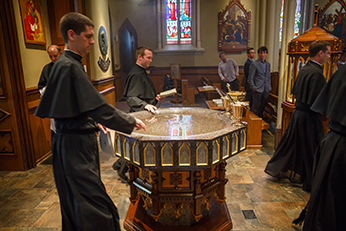 Passing the Baptismal Font