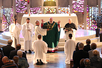 The Deacon Candidates lie prostrate during the Rite of Ordination