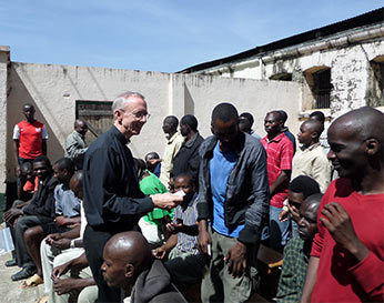 Fr Jim Phalan, CSC sharing Rosaries in Nairobi